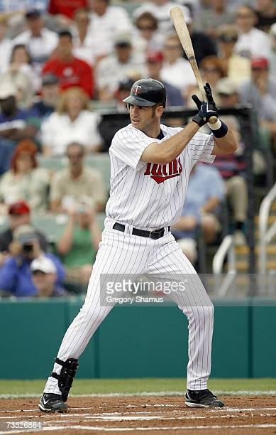 Joe Mauer#7 of the Minnesota Twins stands ready at bat during a Spring Training game against the Boston Red Sox on March 4 2007 at Hammond Stadium in...