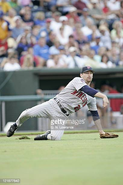 Joe Mays of the Minnesota Twins throws out a runner after a bunt against the Kansas City Royals at Kauffman Stadium in Kansas City Mo on July 9 2005...