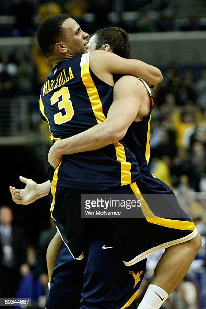 Joe Mazzulla and Jonnie West of the West Virginia Mountaineers celebrate after defeating the Duke Blue Devils during the second round of the West...