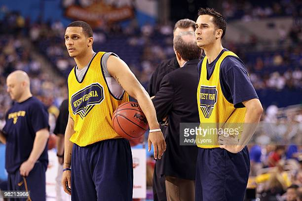 Joe Mazzulla and Jonnie West of the West Virginia Mountaineers look on during practice prior to the 2010 Final Four of the NCAA Division I Men's...