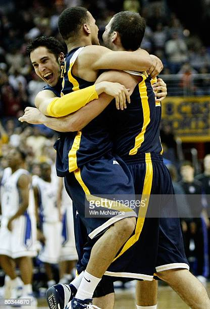 Joe Mazzulla Cam Thoroughman and Jonnie West of the West Virginia Mountaineers celebrate after defeating the Duke Blue Devils during the second round...