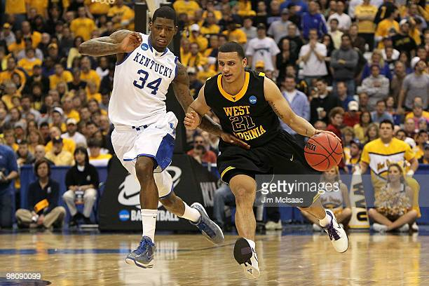 Joe Mazzulla of the West Virginia Mountaineers drives against DeAndre Liggins of the Kentucky Wildcats during the east regional final of the 2010...