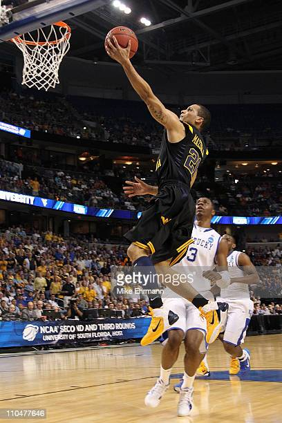 Joe Mazzulla of the West Virginia Mountaineers drives fro a shot attempt against the Kentucky Wildcats during the third round of the 2011 NCAA men's...