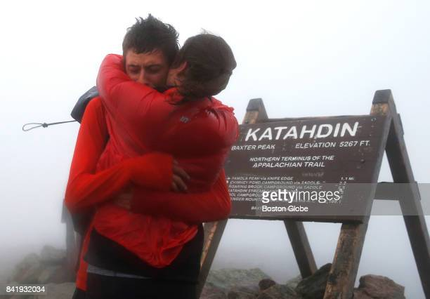 Joe McConaughy embraces his girlfriend Katie Kiracofe as he reaches the summit of Mt Katahdin in Maine in his attempt to break the record for fastest...