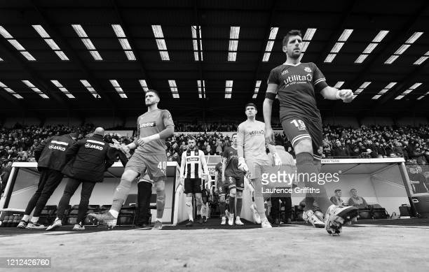 Joe McDonnall of Notts County and Danny Hollands of Eastleigh lead the teams out prior to during the Vanarama National League match between Notts...