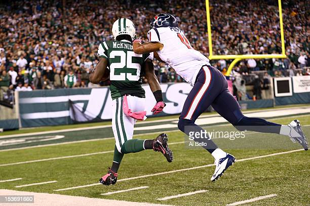 Joe McKnight of the New York Jets returns a kickoff 100 yards for a touchdown in the third quarter against DeVier Posey of the Houston Texans at...