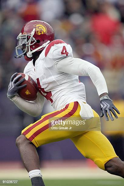 Joe McKnight of the USC Trojans carries the ball during the game against the Washington Huskies on September 19, 2009 at Husky Stadium in Seattle,...