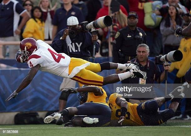 Joe McKnight of the USC Trojans dives in to the endzone for a touchdown during their game against the California Golden Bears at California Memorial...