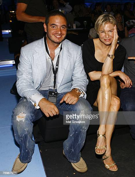 Joe Meli and actress Renee Zellweger attend the Hampton Social @ Ross to watch a concert by Billy Joel at the Ross School on August 4 2007 in East...