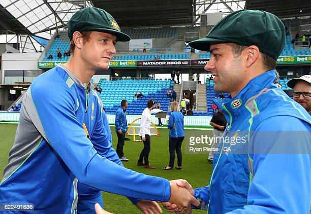 Joe Mennie and Callum Ferguson of Australia congratulate each other after recieving their Baggy Green Caps during day one of the Second Test match...