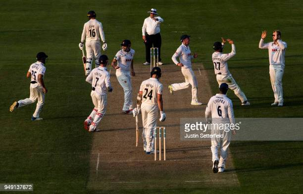 Joe Mennie of Lancashire is caught out by Ravi Bopari of Essex as Essex players celebrate during the Specsavers County Championship Division One...