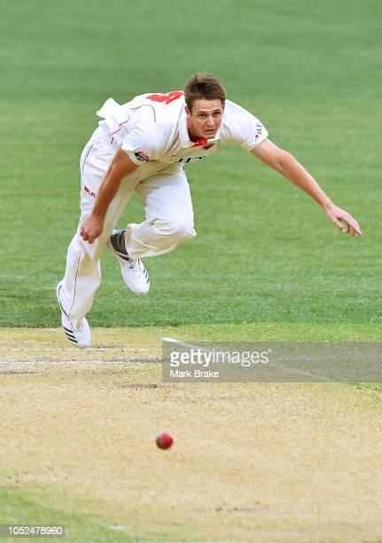 Joe Mennie of the Redbacks bowls to Nick Larkin of the Bluesduring the Sheffield Shield match between South Australia and New South Wales at Adelaide...