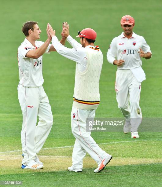 Joe Mennie of the Redbacks celebrates after taking the wicket of Jason Sangha of the Blues during the Sheffield Shield match between South Australia...