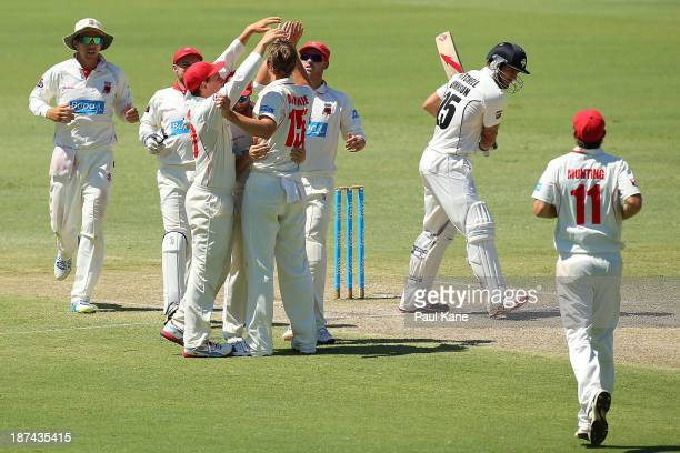 Joe Mennie of the Redbacks celebrates with team mates after dismissing Mitchell Johnson of the Warriors during day four of the Sheffield Shield match...