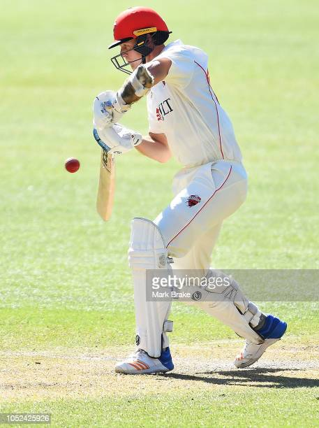 Joe Mennie of the Redbacks edges to point and is caught by Kurtis Patterson of the Blues during the Sheffield Shield match between South Australia...