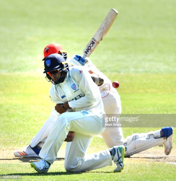 Joe Mennie of the Redbacks hits past Jason Sangha of the Blues during the Sheffield Shield match between South Australia and New South Wales at...