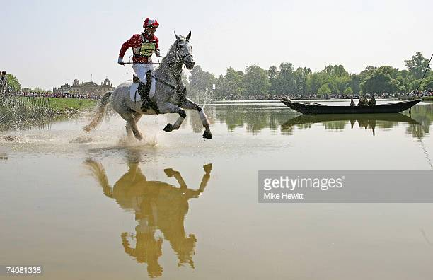 Joe Meyer of New Zealand gallops through the lake during the Mitsubishi Motors Badminton Horse Trials on May 5 2007 in Badminton England