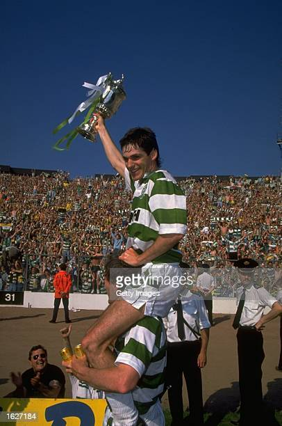 Joe Miller of Celtic celebrates as he rides on his team mates shoulders with the trophy after the Scottish Cup Final match against Rangers at Hampden...