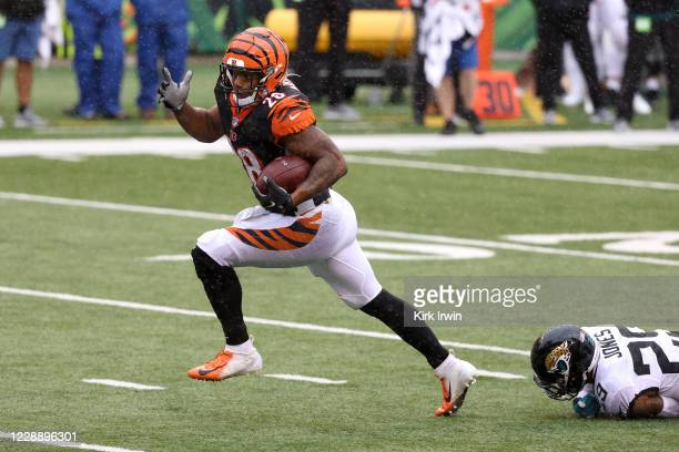 Joe Mixon of the Cincinnati Bengals breaks a tackle by Josh Jones of the Jacksonville Jaguars for a touchdown during the third quarter at Paul Brown...