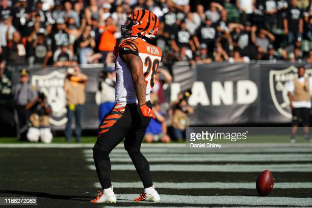 Joe Mixon of the Cincinnati Bengals celebrates scoring a touchdown during the first half against the Oakland Raiders at RingCentral Coliseum on...
