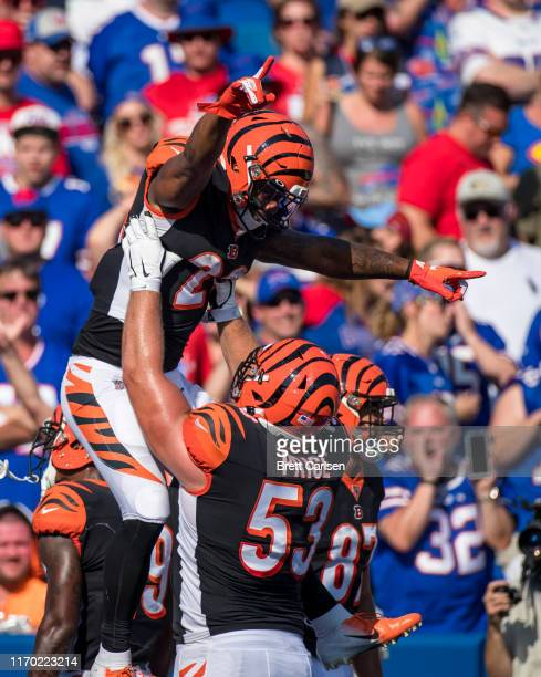 Joe Mixon of the Cincinnati Bengals celebrates the game tying touchdown with Billy Price during the fourth quarter against the Buffalo Bills at New...