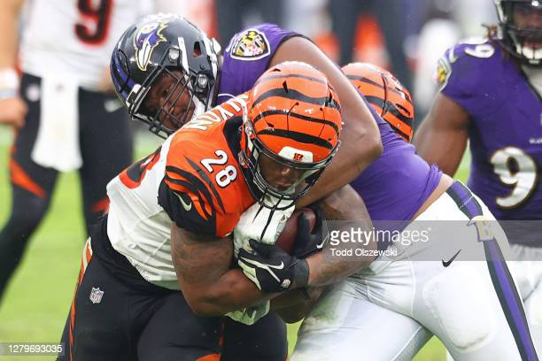 Joe Mixon of the Cincinnati Bengals is tackled as he carries the ball by Calais Campbell of the Baltimore Ravens during the second half at M&T Bank...