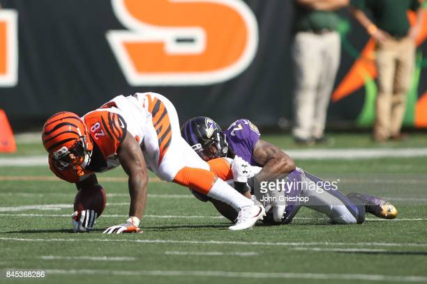 Joe Mixon of the Cincinnati Bengals is tackled by Brandon Carr of the Baltimore Ravens during the fourth quarter at Paul Brown Stadium on September...