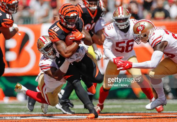 Joe Mixon of the Cincinnati Bengals runs the ball as Dre Greenlaw of the San Francisco 49ers makes the stop during the first half at Paul Brown...