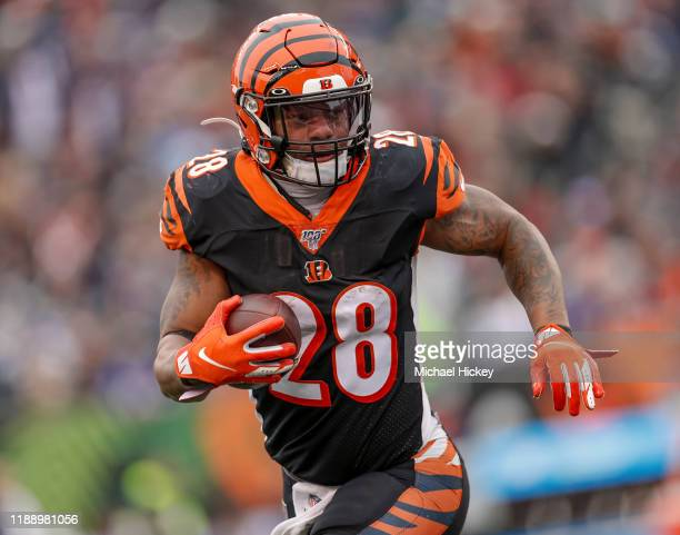 Joe Mixon of the Cincinnati Bengals runs the ball during the second half against the New England Patriots at Paul Brown Stadium on December 15, 2019...
