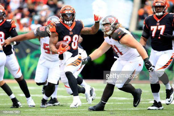 Joe Mixon of the Cincinnati Bengals runs the defense of Beau Allen of the Tampa Bay Buccaneers during the second quarter at Paul Brown Stadium on...