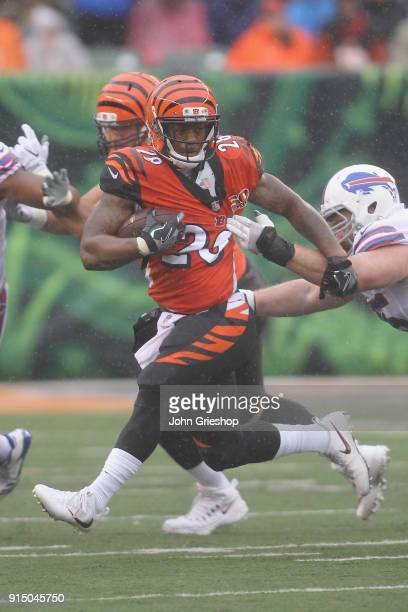 Joe Mixon of the Cincinnati Bengals runs the football upfield during the game against the Buffalo Bills at Paul Brown Stadium on Ocotber 8 2017 in...