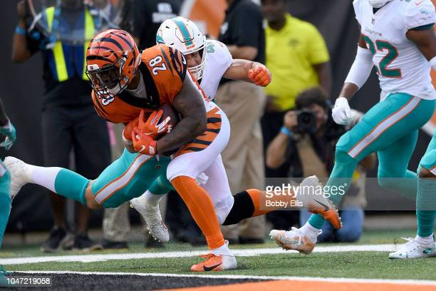 Joe Mixon of the Cincinnati Bengals runs through a tackle by Kiko Alonso of the Miami Dolphins to score a touchdown during the fourth quarter at Paul...
