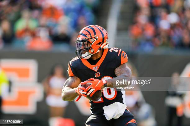 Joe Mixon of the Cincinnati Bengals runs with the ball against the Baltimore Ravens during the third quarter of the game at Paul Brown Stadium on...