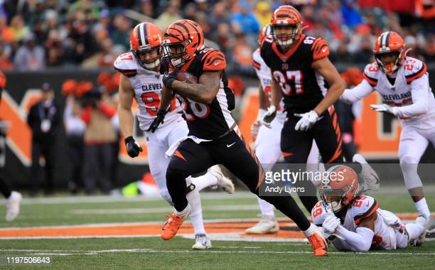 Joe Mixon of the Cincinnati Bengals runs with the ball during the game against the Cleveland Browns at Paul Brown Stadium on December 29, 2019 in...
