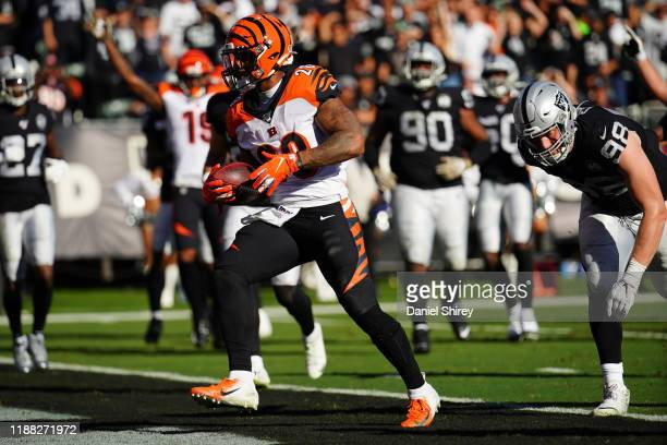 Joe Mixon of the Cincinnati Bengals rushes for a touchdown during the first half against the Oakland Raiders at RingCentral Coliseum on November 17,...