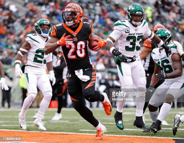 Joe Mixon of the Cincinnati Bengals scores a touchdown during the first half against the New York Jets at Paul Brown Stadium on December 1 2019 in...