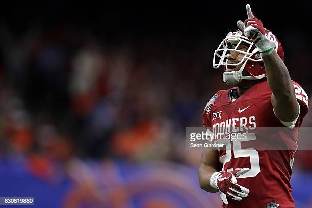 Joe Mixon of the Oklahoma Sooners reacts after a touchdown against the Auburn Tigers during the Allstate Sugar Bowl at the Mercedes-Benz Superdome on...