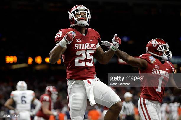 Joe Mixon of the Oklahoma Sooners reacts after scoring a touchdown against the Auburn Tigers during the Allstate Sugar Bowl at the Mercedes-Benz...