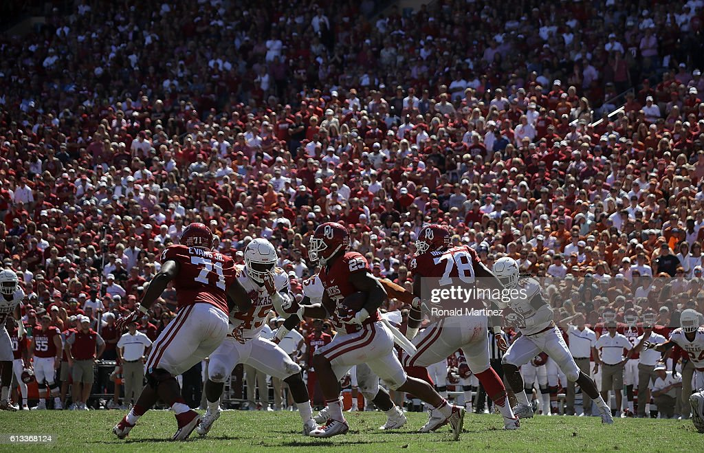 Joe Mixon #25 of the Oklahoma Sooners runs the ball against the Texas Longhorns in the third quarter at Cotton Bowl on October 8, 2016 in Dallas, Texas.