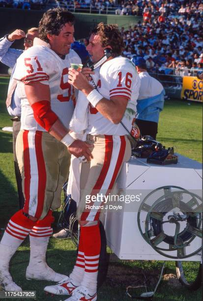 QB Joe Montana and C Randy Cross on the sidelines San Francisco 49ers 48 vs San Diego Chargers 10 at Jack Murphy Stadium in San Diego California
