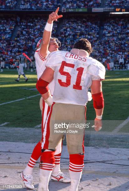 QB Joe Montana C Randy Cross on the sidelines San Francisco 49ers 48 vs San Diego Chargers 10 at Jack Murphy Stadium in San Diego California