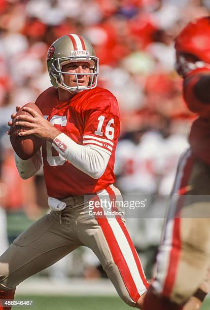 Joe Montana of the San Francisco 49ers attempts a pass during a National Football League game against the Los Angeles Rams played on November 25,...