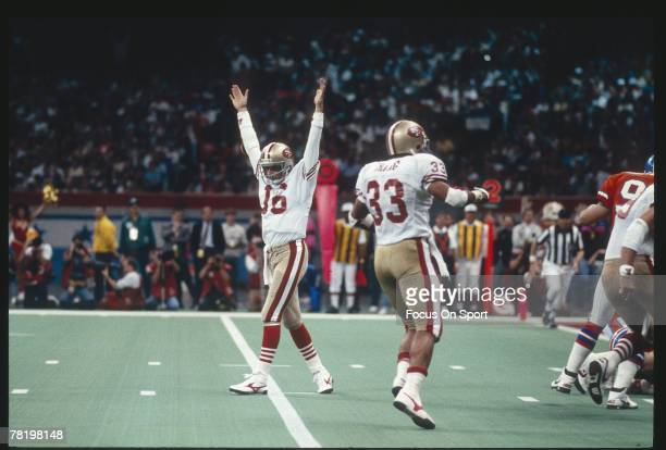 Joe Montana of the San Francisco 49ers celebrates after the 49ers scored against the Denver Broncos during Super Bowl XXIV on January 22 1990 at the...