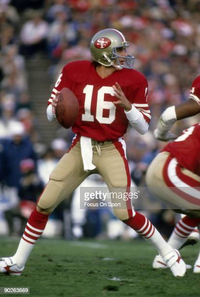 Joe Montana of the San Francisco 49ers drops back to pass against the Miami Dolphins during Super Bowl XIX on January 20, 1985 at Stanford Stadium in...