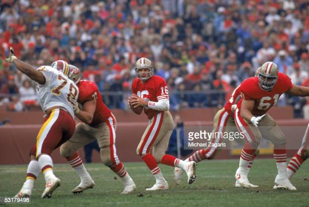 Joe Montana of the San Francisco 49ers drops back to pass during the 1990 NFC Divisional Playoff game against the Washington Redskins at Candlestick...