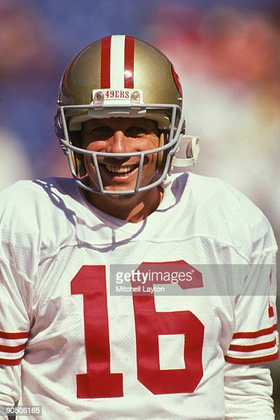 Joe Montana of the San Francisco 49ers looks on before a NFL football game against the Atlanta Falcons on October 14 1990 at Fulton County Stadium in...