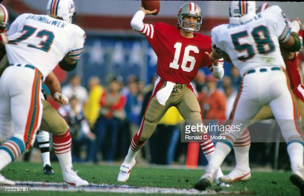 Joe Montana of the San Francisco 49ers passing during Super Bowl XIX against the Miami Dolphins at Stanford Stadium on January 20, 1985 in Stanford,...