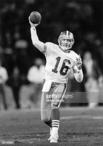 Joe Montana of the San Francisco 49ers throws a pass against the Los Angeles Rams during the game at Anaheim Stadium on December 11, 1989 in Anaheim,...