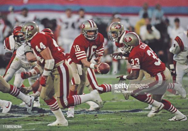 Joe Montana Quarterback for the San Francisco 49ers hands the ball off to running back Roger Craig during the National Football League Super Bowl...