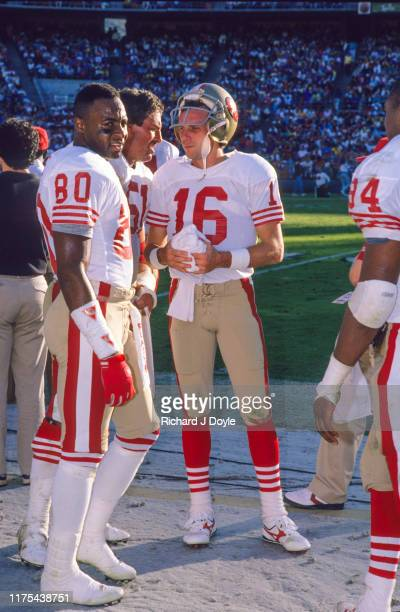 QB Joe Montana WR Jerry Rice C Randy Cross conversing on the sidelines San Francisco 49ers 48 vs San Diego Chargers 10 at Jack Murphy Stadium in San...
